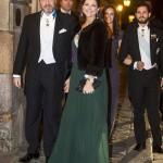 Näin tyytyväinen aviopari asteli Tukholman kuninkaan-linnan juhla-illalliselle joulukuussa. Tosin Madeleinen aviomies ei ole solahtanut kuninkaalliseen rooliinsa erityisen intomielisesti.