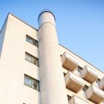 Hotelli Aulangon 30 metriä korkea savupiippu jäi käytöstä sen jälkeen, kun rakennus liitettiin kaukolämpöön.