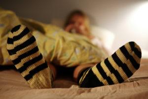 Flunssapotilas sängyssä