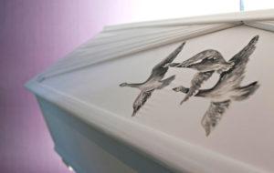 Lintukoristeinen hauta-arkku