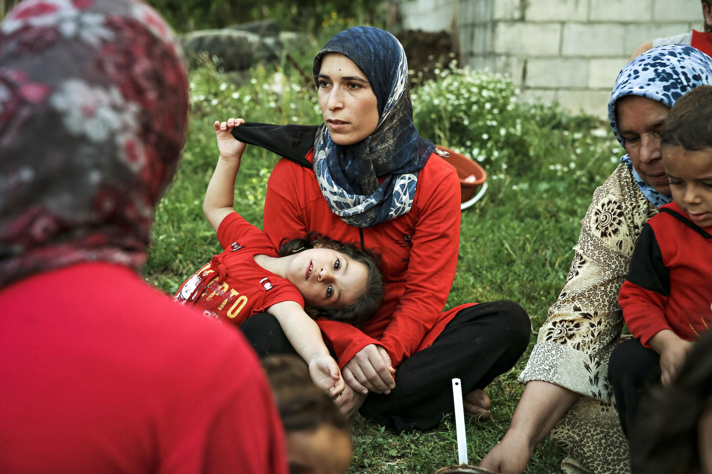 Syyrian pakolaisnaiset ja lapset yrittävät selviytyä päivästä toiseen.