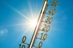 Aurinko ja lämpömittari.