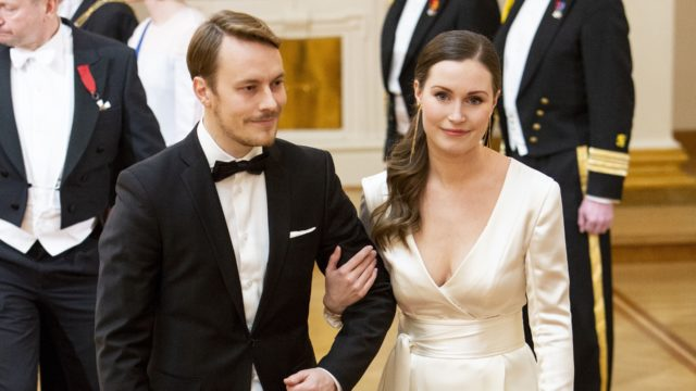 Sanna Marin ja Markus Räikkönen linnan juhlissa vuonna 2018.